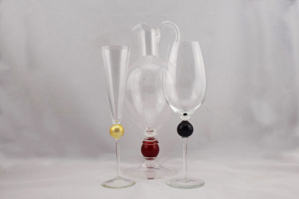 drinking glasses and pithcer gold black red